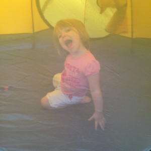 Little One hams it up in the tent.
